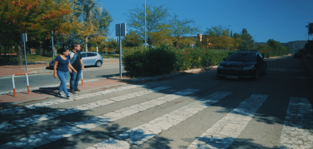 Figure 1. Pedestrians waiting to cross at a pedestrian crossing while looking for eye contact with the driver of an oncoming car.